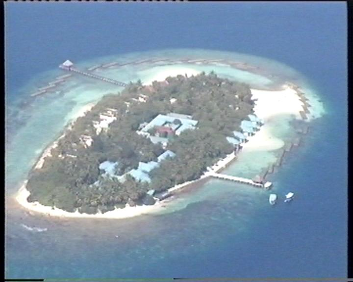 An island in Maldives as seen from a sea plane